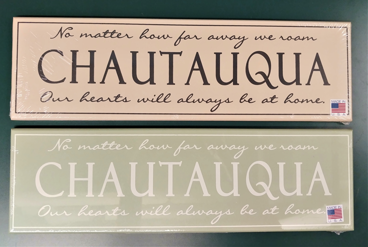 "signs reading: ""No matter how far away we roam our hearts with always be at home: Chautauqua"""
