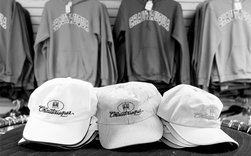 display of Chautauqua-imprint hats and sweatshirts (black and white image)